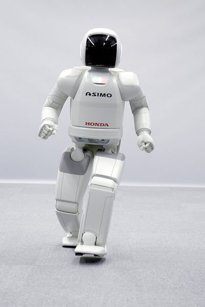 ASIMO robot photo - a humanoid robot manufactured by Honda